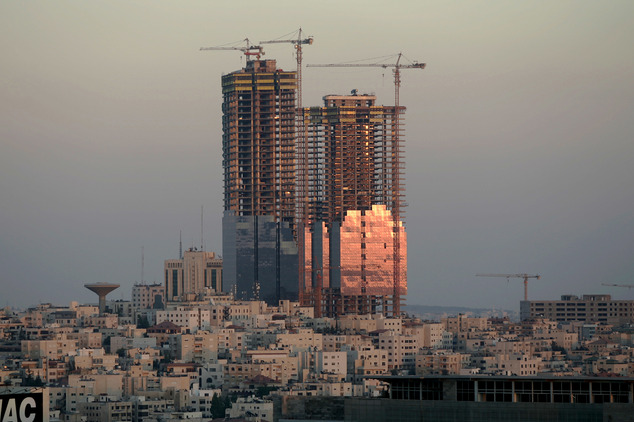 FILE -- In this Sunday, July 6. 2008 file photo, the sunset reflects on the Jordan Gate Towers under construction in Amman, Jordan. Murad Awamleh, a senior o...
