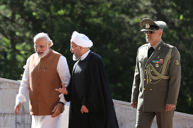 Indian Prime Minister Narendra Modi, left, walks with Iranian President Hassan Rouhani during a welcoming ceremony at the Saadabad Palace in Tehran, Iran, Mo...