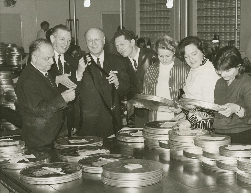 Blockbusters: Among the incredible list of films edited at Denham are classics such as Brief Encounter, The Great Escape, and Star Wars: The Empire Strikes Back. Pictured, a group inspect film at the lab while on a tour of the site