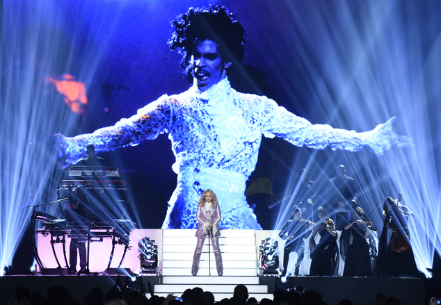 Madonna performs a tribute to Prince, pictured onscreen, at the Billboard Music Awards at the T-Mobile Arena on Sunday, May 22, 2016, in Las Vegas. (Photo by...