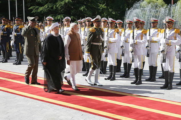 Indian Prime Minister Narendra Modi, third left, reviews an honor guard as he is welcomed by Iranian President Hassan Rouhani, second left, during an officia...