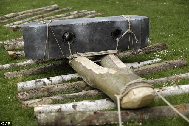 The one tonne block  strapped to a neolithic-style wooden sledge (pictured) during a rest  in the attempt using only people power to move the block