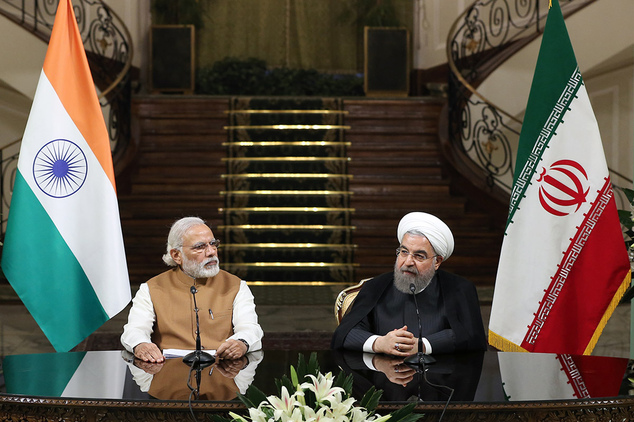 Iranian President Hassan Rouhani, right, speaks with media during a joint press conference with Indian Prime Minister Narendra Modi at the Saadabad Palace in...