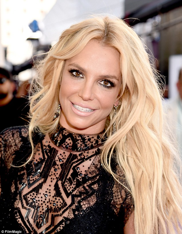 Make-up of the millennium! Britney Spears, 34, may have won the Billboard Music Millennium Award but her nude lipstick and smoky eye deserve their own top honors