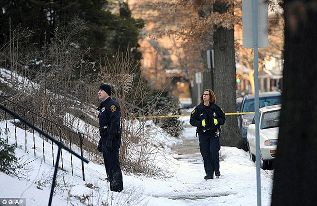 Shocking discovery: Police outside the home of Susan and Sarah Wolfe in February 2014