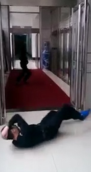 The colleague, assuming he has been shot, starts running frantically back down the corridor in panic