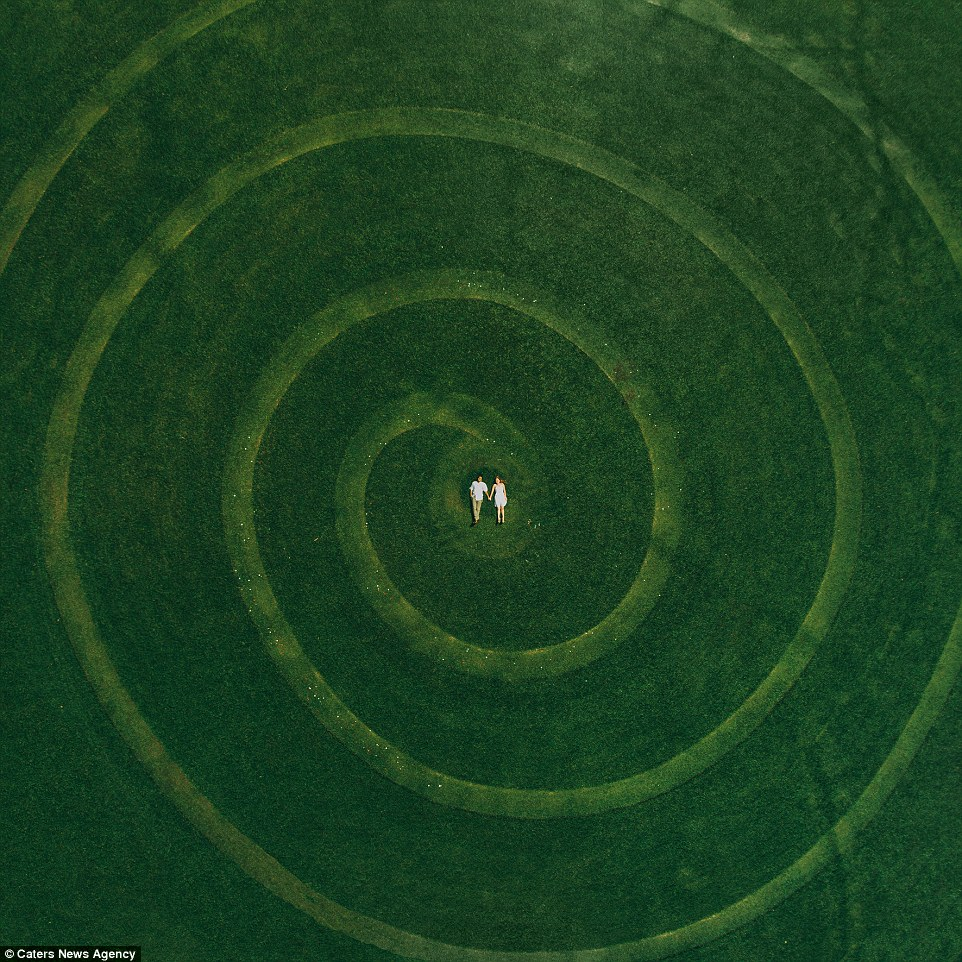 A stunning aerial shot taken by Ekaterina Mukhina shows a couple lying at the centre of the swirls amidst this deep green landscape