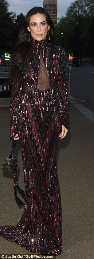 Demi looked splendid in her floorlength glistening gown as she rubbed shoulders with fashion's finest at the plush event