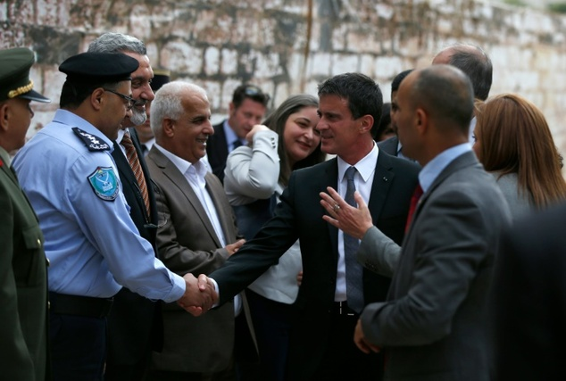 French Prime Minister Manuel Valls (2ndR) and Ziad al-Bandak (3rdR), Palestinian presidential adviser for Christian Affairs, visit the Church of the Nativity...