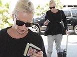 *EXCLUSIVE* Los Angeles, CA - Charlize Theron is seen at LAX catching a departing flight on Memorial Day. The 40-year-old actress is wearing comfy grey joggers and a black top paired with sneakers. \n  \nAKM-GSI       May 30, 2016\nTo License These Photos, Please Contact :\nMaria Buda\n(917) 242-1505\nmbuda@akmgsi.com\nsales@akmgsi.com\nMark Satter\n(317) 691-9592\nmsatter@akmgsi.com\nsales@akmgsi.com