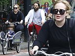 Exclusive Images. Amsterdam, 31st of May 2016; World famous singer Adele is spotted out for a bike ride with her husband Simon and with son Angelo in Amsterdam. \nAdele has several shows in Amsterdam this week and will make sure to make the most out of her stay here.\n