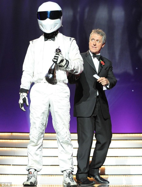 The Stig with the award for 'Top Gear - Most Popular Factual Programme' and Griff Rhys Jones during The National Television Awards 2008 show