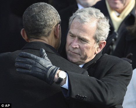 Former President George W. Bush looked emotional as he embraced Barack Obama immediately after he was sworn in as president