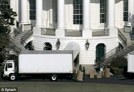 Moving trucks arrive at the White House to quietly move Former President George W Bush out and install his successor Barack Obama