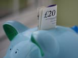 File photo dated 06/01/15 of money in a piggy bank, as savers are choosing current accounts over traditional savings products to build up their nest eggs, research has found.   PRESS ASSOCIATION Photo. Issue date: Sunday February 21, 2016. More than two-fifths (45%) of people are using their current account to build up their savings pots, according to research for Nationwide Building Society. See PA story MONEY Savings. Photo credit should read: Gareth Fuller/PA Wire