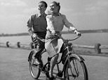 SMILING HAPPY COUPLE MAN WOMAN RIDING TANDEM BICYCLE BUILT FOR TWO AAKRAN 1950s