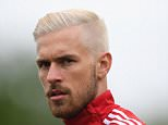 CARDIFF, WALES - JUNE 01:  Wales player Aaron Ramsey with new hairstyle looks on during Wales training at the Vale hotel complex on June 1, 2016 in Cardiff, Wales.  (Photo by Stu Forster/Getty Images)