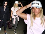 """Sofia Richie and brother Miles Brockman Richie go casual as they arrive together in Los Angeles. Sofia dons a """"Sunset"""" print baseball cap, a pink t-shirt and sweat pants and Miles wears a comfy hoodie and slippers. May 31, 2016. Perez/X17online.com"""