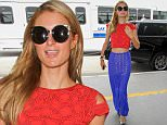 Los Angeles, CA - Paris Hilton wears patriotic colors the day after Memorial day for a flight out of Los Angeles at LAX. The sexy socialite posed for the cameras as she exited her limo and went up the escalator to the security gates.\nAKM-GSI   May 31, 2016\nTo License These Photos, Please Contact :\nMaria Buda\n(917) 242-1505\nmbuda@akmgsi.com\nsales@akmgsi.com\nor \nMark Satter\n(317) 691-9592\nmsatter@akmgsi.com\nsales@akmgsi.com