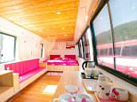 """Pic shows:  The rooms in the old buses converted to hotels. Tourism officials in China are winning over young holiday-goers after they began converting old buses into affordable """"love hotels"""". The lodgings are designed especially for young couples who can now find their home away from home inside an old, disused public bus. While the exterior of the vehicles may still seem unappealing, the more than a dozen old buses parked in a tourist hotspot in Taiyuan, capital of North Chinaís Shanxi Province, are anything but unattractive on the inside. With officials having spent some 100,000 RMB (10,370 GBP) refurbishing the interior of the vehicles, each bus now resembles a quality hotel room, complete with television set, air-conditioner, kitchenette, and bathroom. The couples can have the entire bus for themselves, with the vehicles parked permanently and conveniently near their desired tourist spot. Prices start at an affordable 200 RMB (20 GBP) a night for the rooms, which are decorated in"""