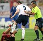 Horacio Elizendo (R) Argentinian referee whistling as English forward Wayne Rooney (C) commits a foul on Portuguese defender Ricardo Carvalho (L) during the World Cup 2006 quarter-final football game between England and Portugal (1-3) at Gelsenkirchen stadium. England striker Wayne Rooney has been suspended for two matches following his World Cup quarter-final red card, a FIFA spokesman told AFP in Berlin 08 July 2006.        AFP PHOTO / FILES /  DDP / VOLKER HARTMANN  (Photo credit should read VOLKER HARTMANN/AFP/Getty Images)