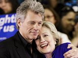 epa05340977 Democratic presidential candidate Sec. Hillary Clinton (R) gets a hug from US musician Jon Bon Jovi (L) while being introduced at a campaign rally at the Golden Dome Athletic Center at Rutgers University in Newark, New Jersey, USA, 01 June 2016. New Jersey is holding its primary on 07 June 2016.  EPA/JUSTIN LANE