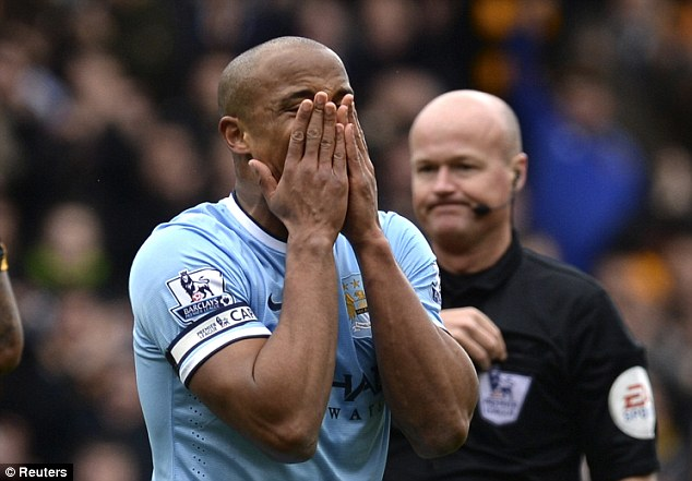 Marching orders: Vincent Kompany shows his disbelief after being shown a straight red by referee Lee Mason