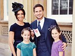 Frank Lampard with partner Christine Bleakley and his daughters Isla and Luna (right) as he holds his Officer of Order of the British Empire (OBE) medal, after it was presented to him by the Duke of Cambridge, at an Investiture ceremony at Buckingham Palace in central London. PRESS ASSOCIATION Photo. Picture date: Tuesday October 27, 2015. See PA story ROYAL Investiture. Photo credit should read: John Stillwell/PA Wire