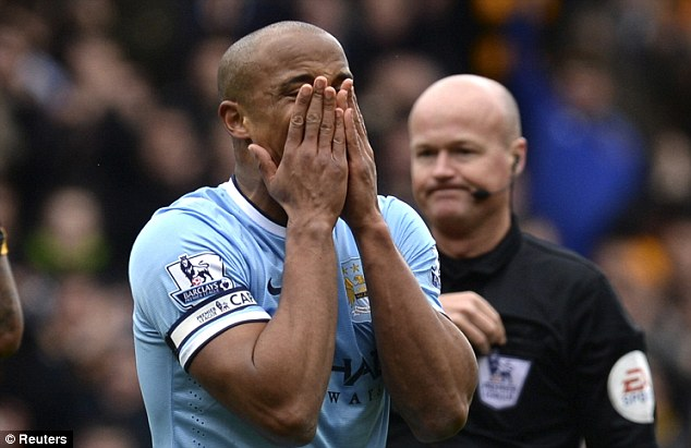 Marching orders: Kompany shows his disbelief after being shown a straight red by referee Lee Mason