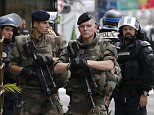 Special intervention French gendarmes, police and soldiers secure the street at the scene of an operation in Paris, France, May 26, 2016.  REUTERS/Benoit Tessier