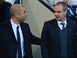 WEST BROMWICH, ENGLAND - NOVEMBER 17: Chelsea manager Roberto Di Matteo speaks to WBA manager Steve Clarke before the Barclays Premier League match between West Bromwich Albion and Chelsea at The Hawthorns on November 17, 2012 in West Bromwich, England.  (Photo by Michael Regan/Getty Images)