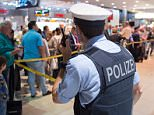 Passengers wait at Terminal 1 at the German airport Cologne/Bonn at the security area, Monday, May 30, 2016. Police say they've taken a man into custody at the airport on suspicion he skirted security screenings in an incident that caused authorities to shut down all departures from Terminal 1 for more than two hours. (Marius Becker/dpa via AP)