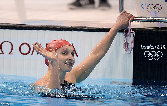 Home favourite: Great Britain's Caitlin McClatchey celebrates winning her heat in the Women's 200m Freestyle