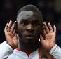 Christian Benteke of Liverpool (front) celebrates with team mates as he scores their second goal from the penalty spot during the Barclays Premier League match between Crystal Palace and Liverpool at Selhurst Park on March 6, 2016 in London, England.       LONDON, ENGLAND - MARCH 06:  (Photo by Mike Hewitt/Getty Images)