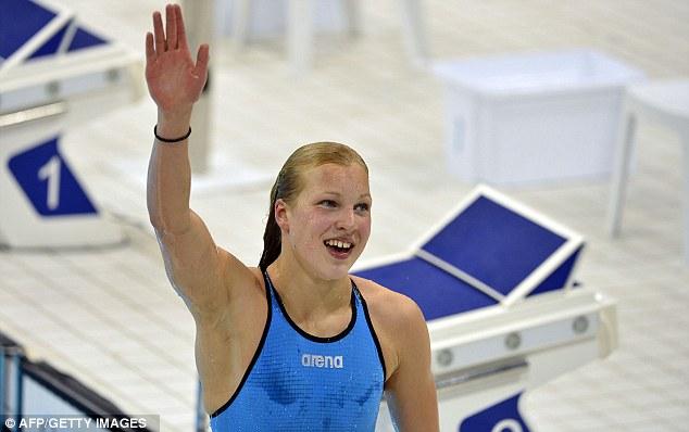 Teenage dream: Lithuania's Ruta Meilutyte, 15, celebrates winning the women's 100m breaststroke final