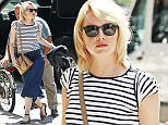 EXCLUSIVE: Emma Stone steps out with her bleached blonde hair and striped T Shirt, NYC  Pictured: Emma Stone Ref: SPL1292985  020616   EXCLUSIVE Picture by: Splash News  Splash News and Pictures Los Angeles: 310-821-2666 New York: 212-619-2666 London: 870-934-2666 photodesk@splashnews.com