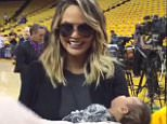 Chrissy Teigen and baby luna at basketball game