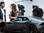 *EXCLUSIVE* West Hollywood, CA - Tyga is seen on set at Last Kings Melrose. The 26-year-old rapper chats up a mystery girl by a Lambo during some down time. Tyga is wearing Puma track pants and a white tee paired with Nike sneakers.\\n\\nAKM-GSI          June 1, 2016\\n\\nTo License These Photos, Please Contact :\\n\\nMaria Buda\\n(917) 242-1505\\nmbuda@akmgsi.com\\nsales@akmgsi.com\\n\\nor \\n\\nMark Satter\\n(317) 691-9592\\nmsatter@akmgsi.com\\nsales@akmgsi.com