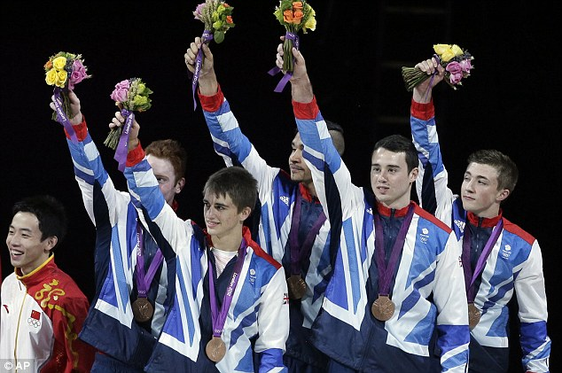 Job done: Great Britain's artistic gymnasts, (left to right), Daniel Purvis, Max Whitlock, Louis Smith, Kristian Thomas and Sam Oldham receive their bronze medals
