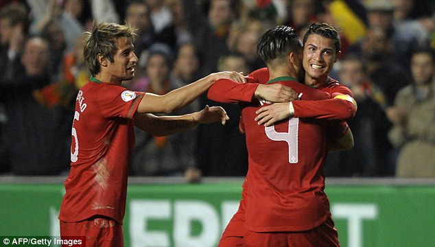 Time to celebrate: Ronaldo (right) celebrates his crucial goal with his Portugal team-mates