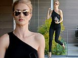 Picture Shows: Rosie Huntington Whiteley  June 02, 2016\n \n VS Angel Rosie Huntington-Whiteley was spotted stopping by her office in West Hollywood, California. She was looking chic with her hair up in a bun and wearing a one-shoulder black top with black jeans.\n \n Non-Exclusive\n UK RIGHTS ONLY\n \n Pictures by : FameFlynet UK © 2016\n Tel : +44 (0)20 3551 5049\n Email : info@fameflynet.uk.com