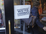 "FILE - In this Wednesday, May 18, 2016, file photo, a woman passes a ""We're Hiring!"" sign while entering a clothing store in the Downtown Crossing of Boston. On Friday, June 3, 2016, the U.S. government issues the May jobs report. (AP Photo/Charles Krupa, File)"