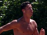 EXCLUSIVE: Cristiano Ronaldo stays in top physical form even while on Holiday. The Real Madrid Supper Star is seen doing some cross training exercise in Ibiza, Spain.  Pictured: cristiano ronaldo and friends sport in ibiza Ref: SPL1293521  020616   EXCLUSIVE Picture by: Silvia & Sergio / Splash News  Splash News and Pictures Los Angeles: 310-821-2666 New York: 212-619-2666 London: 870-934-2666 photodesk@splashnews.com