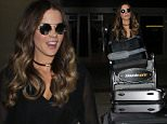 Los Angeles, CA - Kate Beckinsale has her hands full returning to Los Angeles on Thursday. The 42-year-old actress looks effortlessly cool wearing shades and sporting all black with her long locks worn down in waves\n  \nAKM-GSI       June 2, 2016\nTo License These Photos, Please Contact :\nMaria Buda\n(917) 242-1505\nmbuda@akmgsi.com\nsales@akmgsi.com\nMark Satter\n(317) 691-9592\nmsatter@akmgsi.com\nsales@akmgsi.com