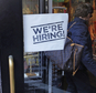 """FILE - In this Wednesday, May 18, 2016, file photo, a woman passes a """"We're Hiring!"""" sign while entering a clothing store in the Downtown Crossing of Boston. On Friday, June 3, 2016, the U.S. government issues the May jobs report. (AP Photo/Charles Krupa, File)"""