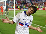 "Andrei Arshavin of Russia celebrates Russia's third goal during the UEFA EURO 2008 Quarter Final match between Netherlands and Russia at St. Jakob-Park on June 21, 2008 in Basel, Switzerland. Arshavin's transfer to English Premier League club Arsenal has been cast into doubt, January  27, 2009 after the 27-year-old's ""excessive wage demands"". (Photo by Alex Livesey/Getty Images),BASEL, SWITZERLAND - (FILE)."