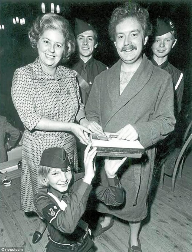 'Jekyll and Hyde': Rev Paul Flowers poses in a dressing down with then MP, later Commons Speaker, Baroness Betty Boothroyd and members of the Boys' Brigade in West Bromwich in 1982