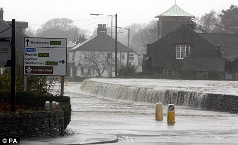 Flood water covers a road in Keswick after the River Greta burst its banks