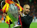 Josep Guardiola manager / head coach of FC Barcelona with the UEFA Champions League Trophy (Photo by AMA/Corbis via Getty Images)