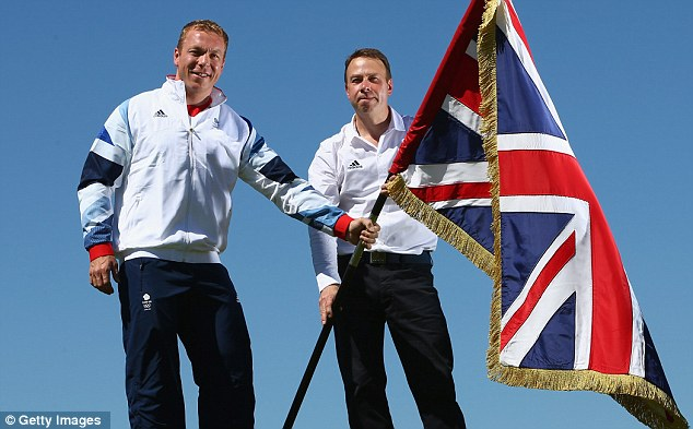 Proud: Sir Chris Hoy (left) poses with the GB flag with Chef de Mission  Andy Hunt at Celtic Manor in Wales